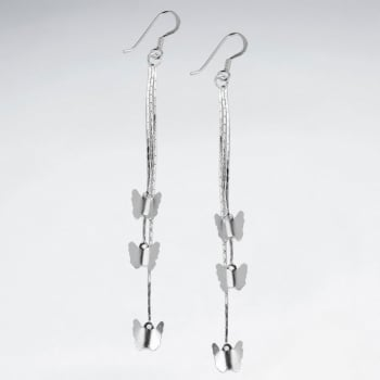 Delicate Butterfly Symphony Cascade Silver Silhouette Earrings